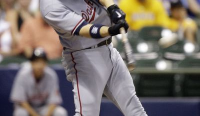 Washington Nationals' Josh Willingham hits a grand slam during the sixth inning of a baseball game against the Milwaukee Brewers Monday, July 27, 2009, in Milwaukee. The grand slam was his second of the game.  (AP Photo/Morry Gash)