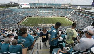 FILE -- This is a Sept. 20, 2009, file photo showing fans in Jacksonville Municipal Stadium stadium during an NFL football game between Arizona Cardinals and the Jacksonville Jaguars, in Jacksonville, Fla.  (AP Photo/Steve Cannon, File)