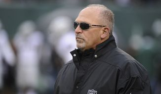 Oakland Raiders assistant head coach Tony Sparano looks on before an NFL football game against the New York Jets, Sunday, Dec. 8, 2013, in East Rutherford, N.J. (AP Photo/Bill Kostroun)