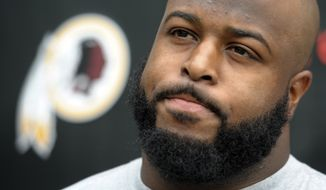 **FILE** Washington Redskin defensive lineman Barry Cofield speaks with reporters during their NFL training camp at Redskins Park in Ashburn, Va., Saturday, July 28, 2012. (AP Photo/Cliff Owen)