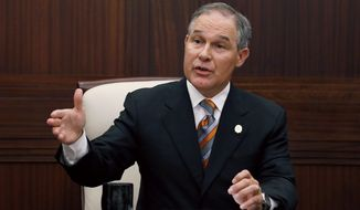 Oklahoma Attorney General Scott Pruitt answers a question during a news conference in Oklahoma City on July 16, 2013. (Associated Press)