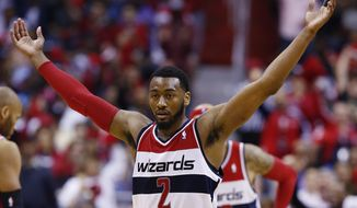 Washington Wizards guard John Wall (2) reacts to a call during the second half of game 4 of an opening-round NBA basketball playoff series in Washington, Sunday, April 27, 2014. (AP Photo/Alex Brandon)