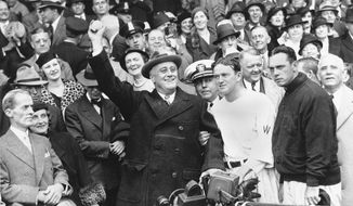 President Franklin D. Roosevelt uncorked an almost wild throw that sent the players scrambling, Oct. 5, 1933, at the start of the third game of the World Series in  Washington, D.C. Joe Cronin and Bill Terry, managers of the Senators and Giants respectively, are standing beside the Chief Executive. Terry has on the jacket. (AP Photo)