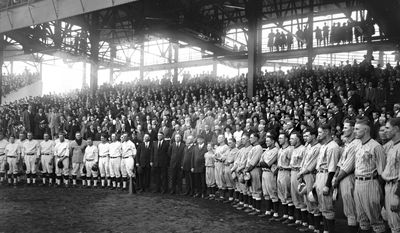 In this Oct. 10, 1924 photo, provided by the Library of Congress, Washington Senators and New York Giants managers and players join umpires before the final game of baseball's World Series in Washington.  (AP Photo/Library of Congress)