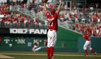 Washington Nationals starting pitcher Jordan Zimmermann (27) celebrates Steven Souza Jr.'s game-ending catch against the Miami Marlins at Nationals Park, Sunday, Sept. 28, 2014, in Washington. Zimmermann pitched a no-hitter, and the Nationals won 1-0.(AP Photo/Alex Brandon)