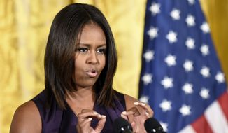 First lady Michelle Obama speaks at a luncheon in the East Room of the White House in Washington, Tuesday, Sept. 30, 2014, to honor of the winners of the 2014 National Design Awards, which are organized by the Smithsonian's Cooper-Hewitt, National Design Museum. (AP Photo/Susan Walsh)