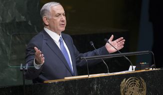 FILE -  In this Monday, Sept. 29, 2014 file photo, Israel's Prime Minister Benjamin Netanyahu addresses the 69th session of the United Nations General Assembly at U.N. headquarters. In a pair of fiery speeches at the United Nations, the Israeli and Palestinian leaders appear to have abandoned any hope of reviving peace talks and instead seem intent on pressing forward with separate diplomatic initiatives that all but ignore each other. Both plans offer novel attempts at breaking months of deadlock, yet both appear doomed to fail. (AP Photo/John Minchillo, File)