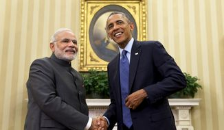 President Barack Obama shakes hands with Indian Prime Minister Narendra Modi on Sept. 30, 2014, in the Oval Office of the White House. (Associated Press)