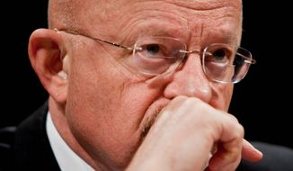 James Clapper          T.J. Kirkpatrick/The Washington Times