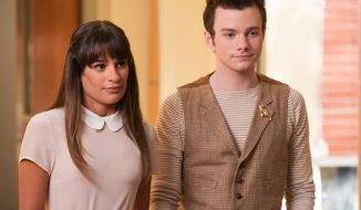 "This photo released by Fox shows, Lea Michele, left, and Chris Colfer, in a scene from ""Glee."" The media advocacy group GLAAD on Wednesday, Oct. 1, 2014, released its annual report on diversity on TV, including depictions of gay characters. (AP Photo/Fox, Eddy Chen)"