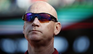 Washington Nationals manager Matt Williams (9) stands during the National Anthem before a baseball game against the Miami Marlins at Nationals Park, Saturday, Sept. 27, 2014, in Washington. (AP Photo/Alex Brandon)