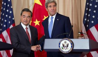 Secretary of State John Kerry shakes hands with Chinese Foreign Minister Wang Yi at the State Department in Washington, Wednesday, Oct. 1, 2014.   (AP Photo/Manuel Balce Ceneta)