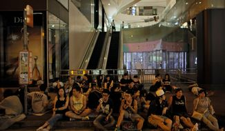 Investing in future: Protesters who have forced shops in Hong Kong to close and the stock market to plunge are gambling on a payoff in greater democracy. (Associated Press)