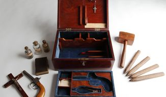 "Undated handout photo issued by the British Library  on Thursday Oct. 2, 2014 of a Victorian vampire slaying kit on display in Terror and Wonder: The Gothic Imagination exhibition, at the British Library, in London. The gothic  genre that has been spooking readers and viewers for centuries. It's the subject of a new exhibition at the British Library that explores 250 years of chills, thrills and bloody excess whose influence runs from the pages of Mary Shelley's ""Frankenstein"" to the clothes of Alexander McQueen. The exhibition at the  British Library in London runs from Friday Oct. 3, until Jan. 20(AP Photo/Royal Armouries/British Library) NO ARCHIVE"