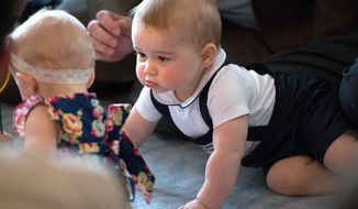 Britain's Prince George, right, plays during a visit to Plunket nurse and parents group at Government House in Wellington, New Zealand, in this April 9, 2014. Prince William and his wife Kate are threatening to take legal action against a photographer they say has been monitoring their toddler son Prince George. (AP Photo/Marty Melville, Pool, file)