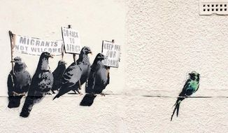 In this released by banksy.co.uk on Thursday, Oct. 2, 2014, shows a mural by graffiti artist Bansky in Clacton-on-Sea England taken earlier this week. (AP Photo/banksy.co.uk)
