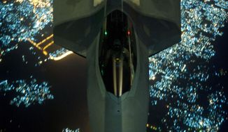 AP10ThingsToSee - In this Friday, Sept. 26, 2014 photo, released by the U.S. Air Force, a U.S Air Force KC-10 Extender refuels an F-22 Raptor fighter aircraft prior to strike operations in Syria. The F-22s, making their combat debut, were part of a strike package that was engaging Islamic State group targets in Syria. Washington and its Arab allies opened the air assault against the extremist group on Sept. 23, striking military facilities, training camps, heavy weapons and oil installations. The campaign expands upon the airstrikes the United States has been conducting against the militants in Iraq since early August. (AP Photo/U.S. Air Force, Russ Scalf )
