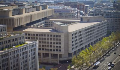 The J. Edgar Hoover building in Washington, which serves as the Federal Bureau of Investigation's headquarters, is seen here on April 26, 2014. (Associated Press) **FILE**