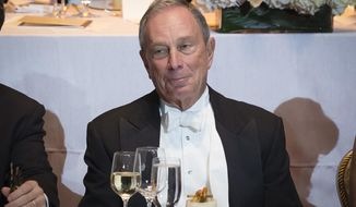 Former New York Mayor Michael Bloomberg reacts to a joke at his expense during the 69th Annual Alfred E. Smith Memorial Foundation Dinner, a charity gala organized by the Archdiocese of New York, at the Waldorf-Astoria hotel, Wednesday, Oct. 1, 2014, in New York. (AP Photo/John Minchillo)