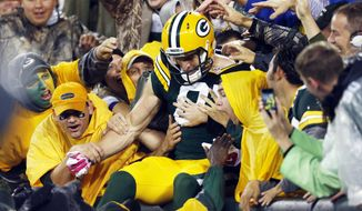 Green Bay Packers' Jordy Nelson celebrates with fans after catching a 66-yard touchdown pass during the first half of an NFL football game against the Minnesota Vikings Thursday, Oct. 2, 2014, in Green Bay, Wis. (AP Photo/Mike Roemer)