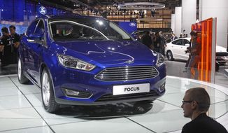 A Ford Focus is presented at the Paris Motor Show, in Paris, Thursday Oct. 2, 2014. The Paris Motor Show will open its doors to the public on Saturday Oct. 4, until Oct. 19.  European carmakers are hoping to impress with new models at this week's Paris Motor Show and prove they have come out stronger from years of economic trouble and cost-cutting. (AP Photo/Remy de la Mauviniere)