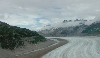 The Meade glacier fills a valley outside Skagway Alaska. At its lower elevations, it looks like a broad freeway, or river of ice. Photo by Curtis Ellis