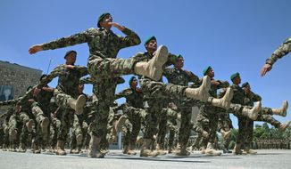 Afghanistan National Army soldiers march during their graduation ceremony at the Kabul Military Training Center in Kabul, Afghanistan on June 1, 2014. (Associated Press) ** FILE **