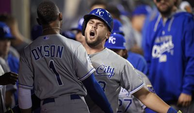 Kansas City Royals' Mike Moustakas celebrates his home run with Jarrod Dyson, during the 11th inning against the Los Angeles Angels in Game 1 of baseball's AL Division Series in Anaheim, Calif., Thursday, Oct. 2, 2014. (AP Photo/Mark J. Terrill)