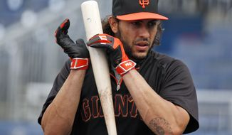 San Francisco Giants' Michael Morse listens as he taps his bat during an MLB baseball workout at Nationals Park, Thursday, Oct. 2, 2014, in Washington. The Washington Nationals play the San Francisco Giants in the National League Division Series starting Friday. (AP Photo/Alex Brandon)