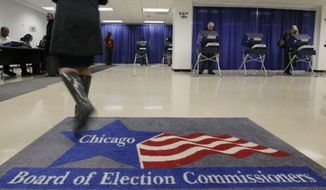 FILE - In this Jan. 27, 2010 file photo, voters cast their ballots for Illinois' primary at an early voting polling location in Chicago.  Illinois Republicans are mounting what they say is an unprecedented and costly campaign to identify and eliminate ineligible voters and recruit their own election judges before the November vote. With their sights on unseating a Democratic governor and winning back several congressional seats, Republicans have allocated $1 million in Cook County alone to examine voter rolls and recruit 5,000 GOP election judges to watch over polling places in Democrat-heavy Chicago. (AP Photo/M. Spencer Green,File)