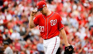 Washington Nationals starting pitcher Stephen Strasburg (37) walks back to the dugout after pitching in the second inning as the Washington Nationals play the San Francisco Giants at Nationals Park for Game 1 of the National League Division Series, Washington, D.C., Friday, October 3, 2014. (Andrew Harnik/The Washington Times)