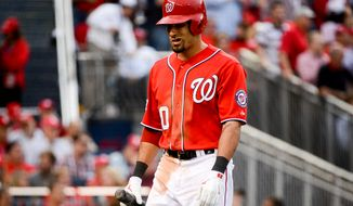 Washington Nationals shortstop Ian Desmond (20) strikes out with bases loaded to end the sixth inning as the Washington Nationals play the San Francisco Giants at Nationals Park for Game 1 of the National League Division Series, Washington, D.C., Friday, October 3, 2014. (Andrew Harnik/The Washington Times)