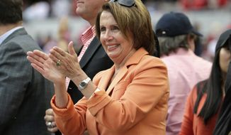 House Minority Leader Nancy Pelosi, D-Calif., cheers during the third inning of Game 1 of baseball's NL Division Series between the Washington Nationals and the San Francisco Giants, Friday, Oct. 3, 2014, at Nationals Park in Washington. (AP Photo/Pablo Martinez Monsivais)