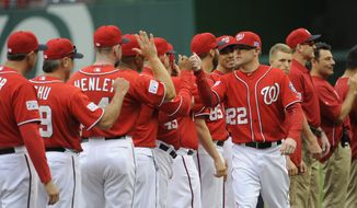 Washington Nationals relief pitcher Drew Storen (22) greets teammates during introductions before Game 1 of baseball's NL Division Series against the San Francisco Giants at Nationals Park, Friday, Oct. 3, 2014. (AP Photo/Toni L. Sandys, Pool)