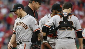 San Francisco Giants starting pitcher Jake Peavy, left, reacts as he leaves the mound during the sixth inning of Game 1 of baseball's NL Division Series against the Washington Nationals at Nationals Park, Friday, Oct. 3, 2014, in Washington. (AP Photo/Alex Brandon)