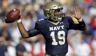 Navy quarterback Keenan Reynolds throws to a receiver in the first half of an NCAA college football game against Rutgers in Annapolis, Md., Saturday, Sept. 20, 2014. (AP Photo/Patrick Semansky)
