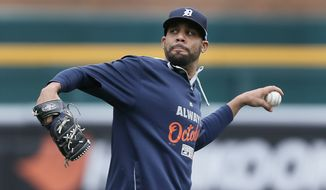 Detroit Tigers pitcher David Price throws during practice in preparation for Game 3 of baseball's American League Division Series in Detroit Saturday, Oct. 4, 2014. Baltimore leads the best-of-five games series 2-0. (AP Photo/Paul Sancya)