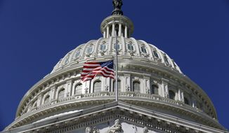 The American Flag flies at half staff on Capitol Hill in Washington, Tuesday, Sept. 11, 2012, before a Congressional remembrance ceremony for the events of 9/11. (AP Photo/Alex Brandon)