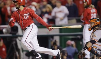 Washington Nationals third baseman Anthony Rendon (6) watches his single during the eighth inning in Game 2 of baseball's NL Division Series against the San Francisco Giants in Nationals Park, Saturday, Oct. 4, 2014, in Washington. (AP Photo/Patrick Semansky)