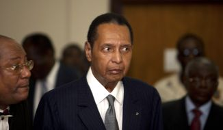 "In this Feb. 28, 2013, file photo, former Haitian dictator Jean-Claude Duvalier, known as ""Baby Doc,"" attends his hearing at court in Port-au-Prince, Haiti.  Duvalier, the self-proclaimed ""president for life"" of Haiti whose corrupt and brutal regime sparked a popular uprising that sent him into a 25-year exile, died Saturday, Oct. 4, 2014, of a heart attack, his attorney said.  He was 63. (AP Photo/Dieu Nalio Chery, File)"
