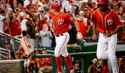 Washington Nationals second baseman Asdrubal Cabrera (3) hits a home run single in the seventh inning as the Washington Nationals play the San Francisco Giants at Nationals Park for Game 1 of the National League Division Series, Washington, D.C., Friday, October 3, 2014. (Andrew Harnik/The Washington Times)
