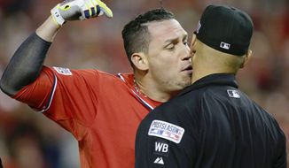 Washington Nationals' Asdrubal Cabrera argues his strike out call with home plate umpire Vic Carapazza in the tenth inning of Game 2 of baseball's NL Division Series against the San Francisco Giants at Nationals Park, Saturday, Oct. 4, 2014, in Washington. Cabrera was ejected from the game. (AP Photo/Mark Tenally)