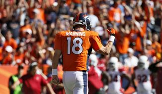 Denver Broncos quarterback Peyton Manning (18) reacts to his 500th career touchdown pass during the first half of an NFL football game against the Arizona Cardinals, Sunday, Oct. 5, 2014, in Denver. (AP Photo/Jack Dempsey)