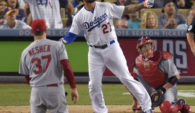 Los Angeles Dodgers' Matt Kemp watches his home run off St. Louis Cardinals relief pitcher Pat Neshek during the eighth inning in Game 2 of baseball's NL Division Series in Los Angeles, Saturday, Oct. 4, 2014. (AP Photo/Mark J. Terrill)