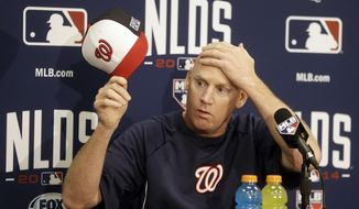 Washington Nationals' manager Matt Williams  removes his cap while answering questions during a news conference Sunday, Oct. 5, 2014, in San Francisco. The Giants are scheduled to face the Washington Nationals in Game 3 of the NL Division Baseball Series on Monday. (AP Photo/Ben Margot)