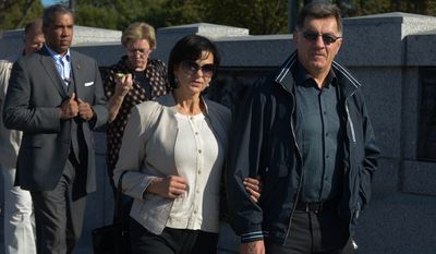 Algirdas ButkeviÄius, Prime Minister of Lithuania, and his wife Janina enjoying the sights of the WWII Memorial in Northwest on Sunday, October 5, 2014. Khalid Naji-Allah/Special to The Washington Times.