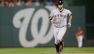 San Francisco Giants' Brandon Belt runs the bases after hitting a solo home run in the 18th inning of Game 2 of baseball's NL Division Series against the Washington Nationals in Nationals Park, Saturday, Oct. 4, 2014, in Washington. (AP Photo/Patrick Semansky)