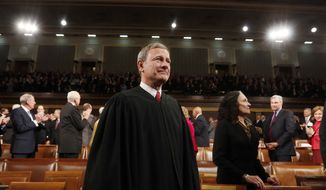 FILE - This Jan. 28, 2014 file photo shows Supreme Court Chief Justice John Roberts in the House chamber on Capitol Hill waiting for the President's State of the Union address to begin. Roberts is beginning his 10th year at the head of the Supreme Court, and the fifth with the same lineup of justices. He has been part of a five-justice conservative majority that has rolled back campaign finance limits, upheld abortion restrictions and been generally skeptical of the consideration of race in public life. But his court has taken a different path in cases involving gay and lesbian Americans, despite the chief justice's opposition most of the time. (AP Photo/Larry Downing, Pool)