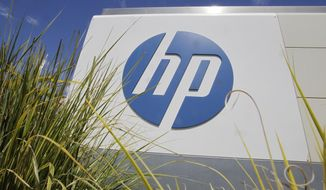 In this Aug. 21, 2012, file photo, the Hewlett-Packard Co. logo is seen outside the company's headquarters in Palo Alto, Calif. Hewlett-Packard Co. is splitting itself into two companies, one focused on its personal computer and printing business and another on technology services, such as data storage, servers and software, as it aims to drive stronger profitability. (AP Photo/Paul Sakuma, File)