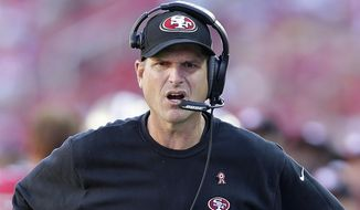 San Francisco 49ers head coach Jim Harbaugh walks on the sideline during the second half of an NFL football game against the Kansas City Chiefs in Santa Clara, Calif., Sunday, Oct. 5, 2014. (AP Photo/Marcio Jose Sanchez)